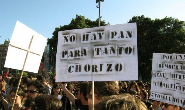 Una pancarta durant una manifestació al·ludeix a la situació de corrupció que ha sacsejat l'Estat en els últims anys